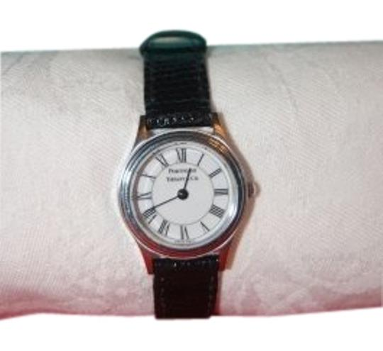 Preload https://item3.tradesy.com/images/tiffany-and-co-black-leather-strap-white-face-portfolio-classic-dial-watch-22207-0-1.jpg?width=440&height=440