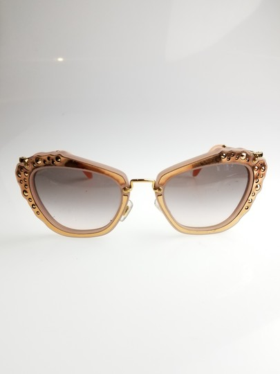 ce0ace3278 Miu Miu Cat Eye Sunglasses Pink