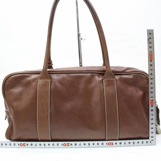 Prada High-end Bohemian Classic Style Great For Everyday Has Lock & Keyring Excellent Vintage Satchel in buttery leather in a medium brown