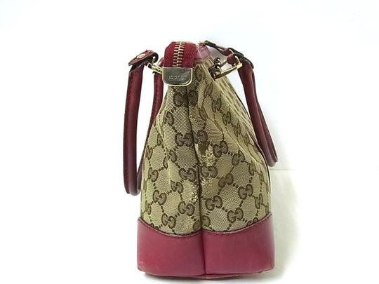 Gucci Perfect Everyday Comes With Dustbag Roomy & Organized Excellent Condition Unique Color Combo Satchel in dark brown large G logo print canvas and dark red/pink leather