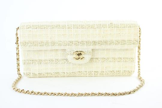Preload https://img-static.tradesy.com/item/22213184/chanel-east-west-quilted-woven-flap-221885-cream-tweed-shoulder-bag-0-1-540-540.jpg