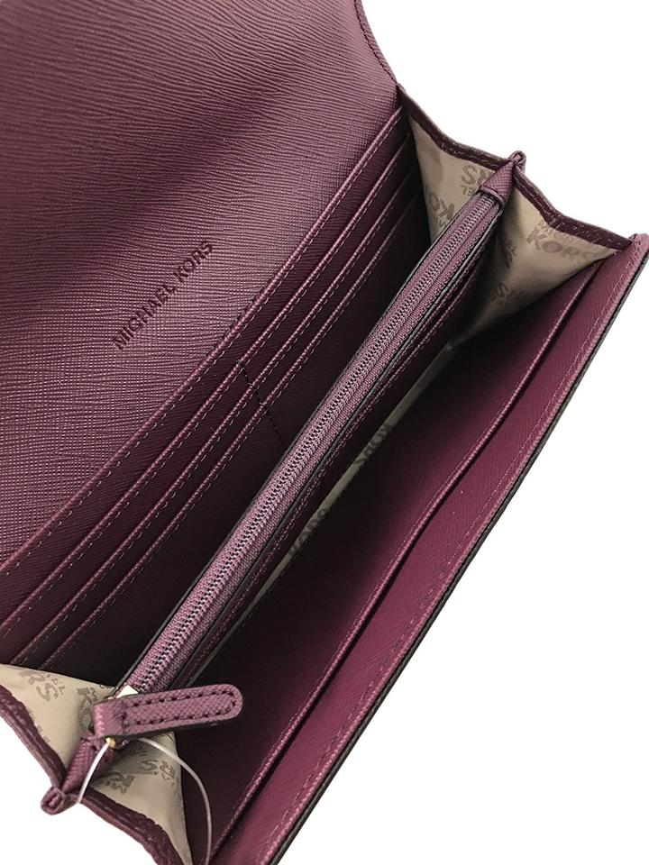 0a9d07ef427b ... discount code for michael kors plum fulton flap continental leather  clutch in wallet 8c6a7 8f6a9