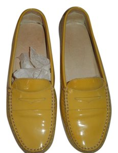 Tod's yellow leather Flats