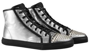 Gucci Silver metallic with silver studs. Black laces and black trim. Athletic