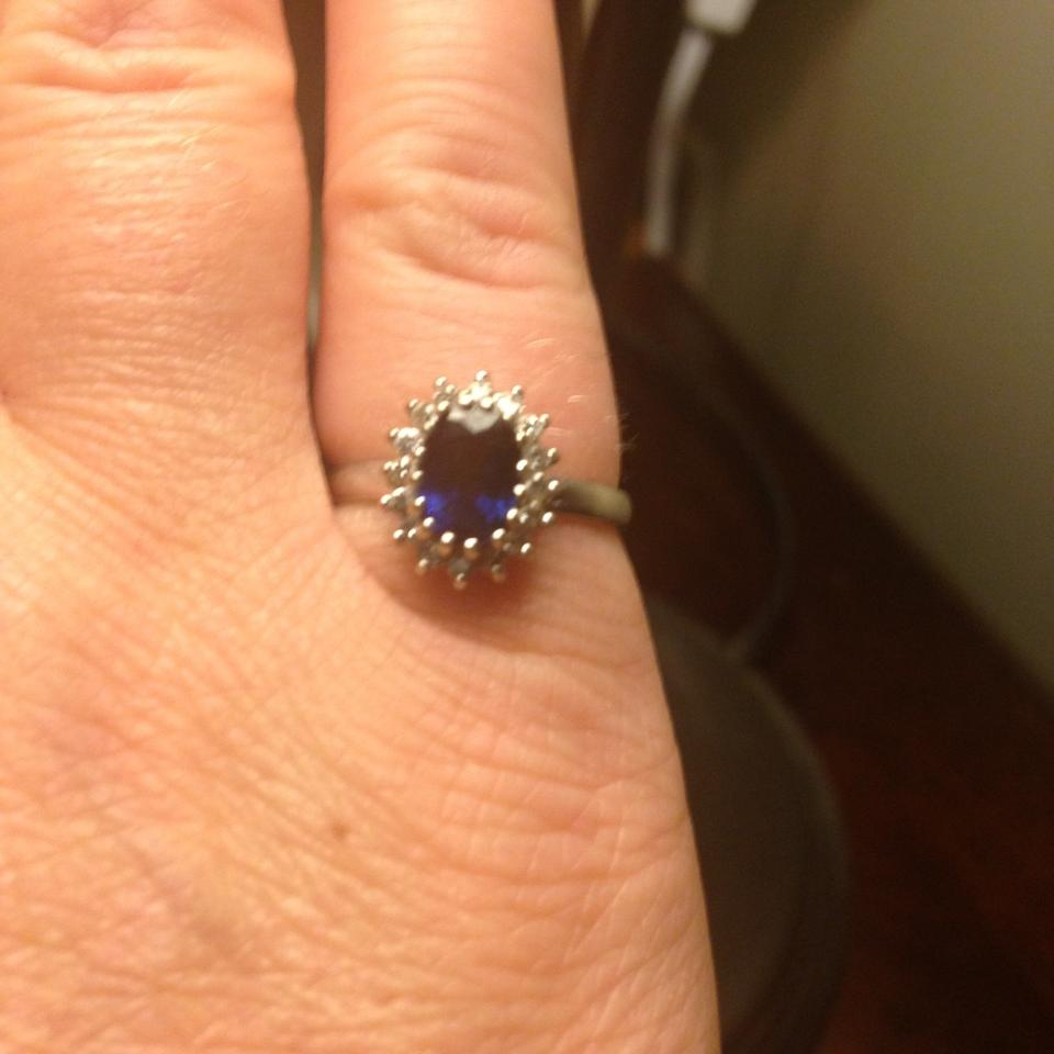 Deep Blue Oval Sapphire with Diamonds Surrounded White ...