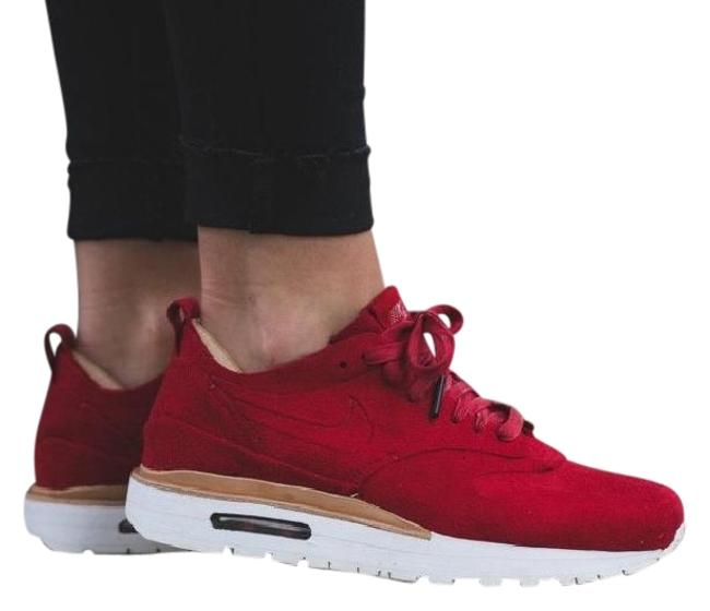Item - Red Women's Air Max 1 Royal Features A Synthetic Suede Upper with Deluxe Detailing. Style/Color: Sneakers Size US 10 Narrow (Aa, N)