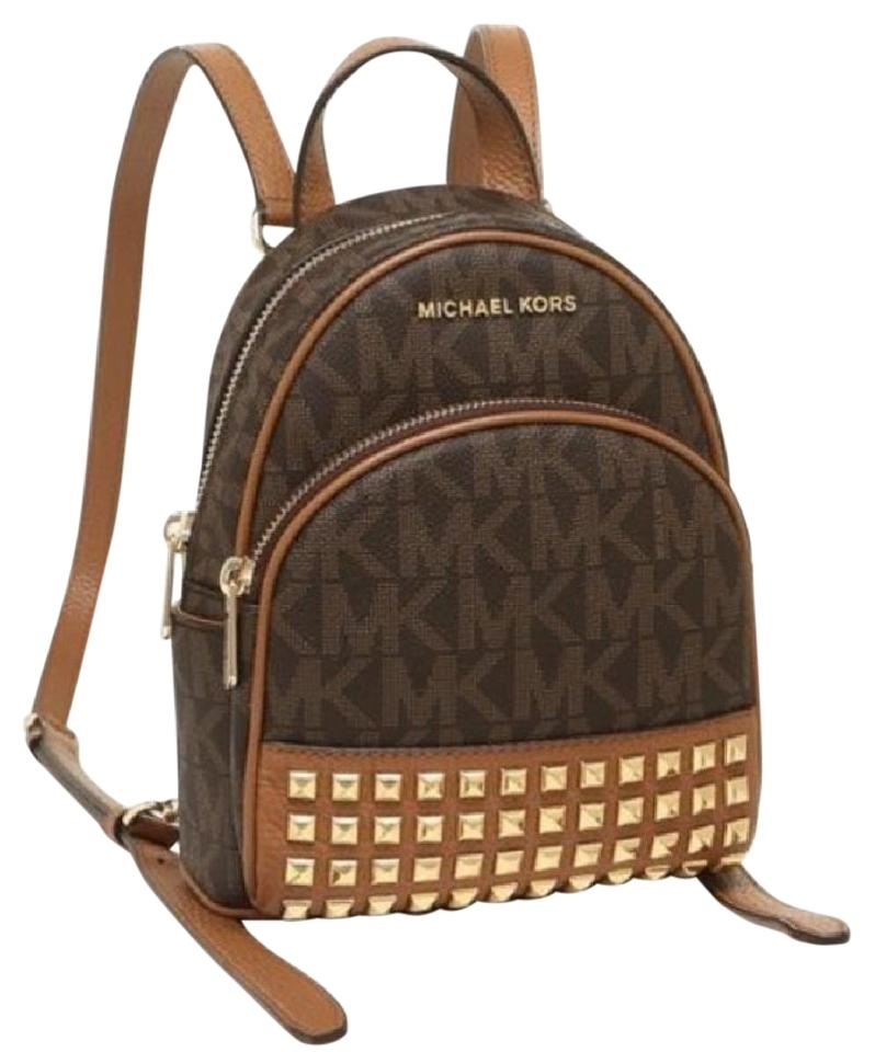 69b5264db8e449 Michael Kors Abbey Xs Signature Crossbody Brown Acorn Leather Canvas  Backpack
