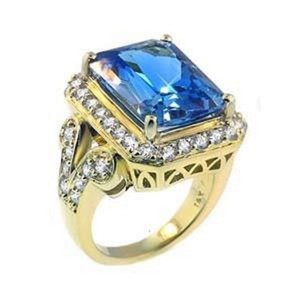 SWD BLUE TOPAZ RING WITH DIAMONDS IN YELLOW GOLD