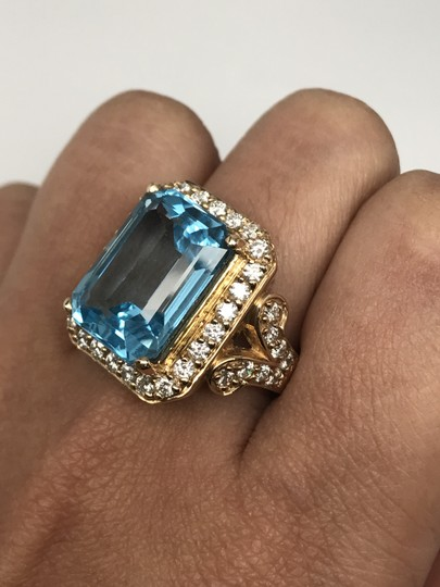 SWD BLUE TOPAZ RING WITH DIAMONDS IN YELLOW GOLD Image 1