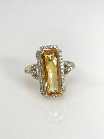 SWD TOPAZ AND DIAMOND FASHION RING IN 18K YELLOW GOLD Image 1