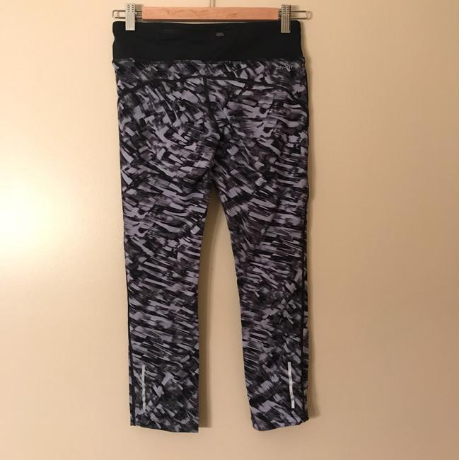Nike Dri-fit graphic run crops Image 1