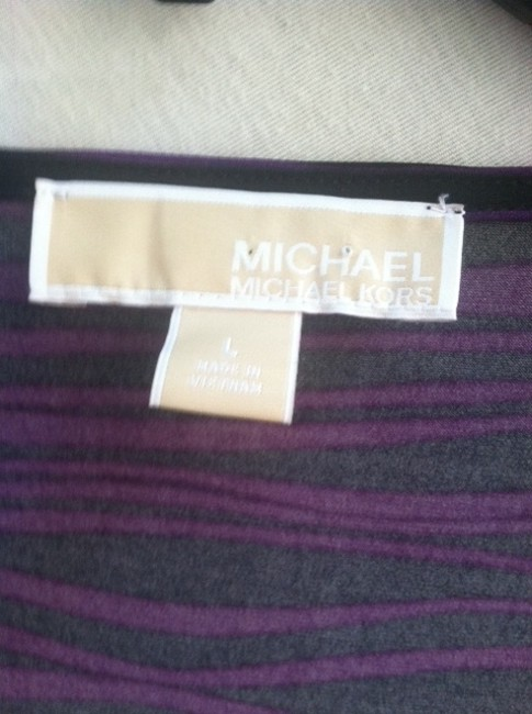 Michael Kors Silver Buckle. Top Black and Purple
