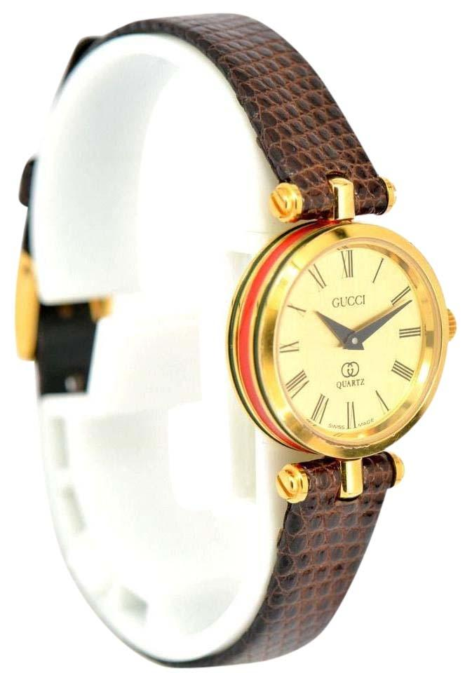 00f10fa15d8 Gucci Vintage Ribbon Line Gold Leather Quartz Watch Image 0 ...