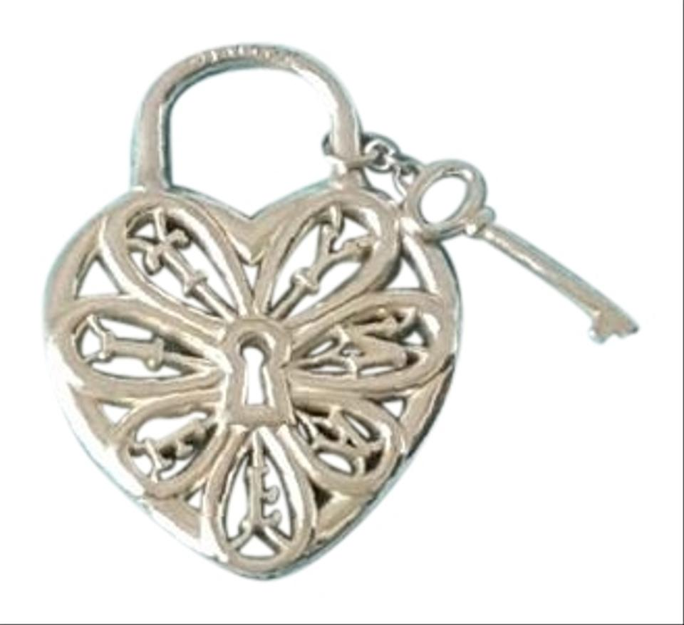 Tiffany co co sterling silver filigree heart tag key pendant tiffany co tiffany co sterling silver filigree heart tag key charm pendant aloadofball Choice Image