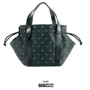 Kate Spade Tote in black with whole Polka dots