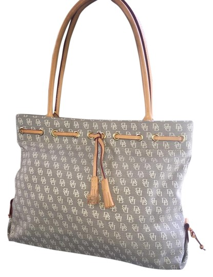 Whether you're out for lunch or out for the weekend, this Dooney & Bourke Lee leather tote keeps your daily essentials right where you need them. Page 1.