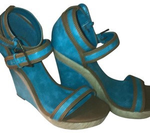 Michael Antonio turquoise and brown Wedges