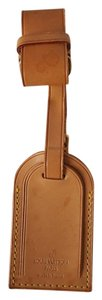 Louis Vuitton Baggage Tag with the luggage strap fastener