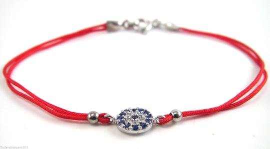 Other CUBIC ZIRCONIUM EVIL EYE BRACELET ON RED CORD