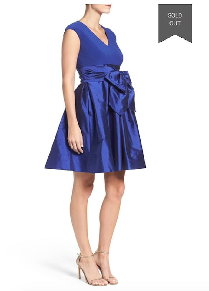 9119c730a7 Adrianna Papell Sapphire Slimming Stretch Sheath Flaunts A Paneled ...