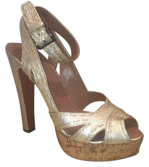 Preload https://item5.tradesy.com/images/alaia-sexy-shoe-pump-snakeskin-tan-and-gold-pumps-2230264-0-1.jpg?width=440&height=440