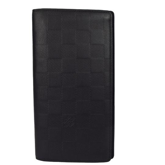 Preload https://img-static.tradesy.com/item/22306146/louis-vuitton-bifold-long-wallet-purse-damier-infini-black-leather-clutch-0-0-540-540.jpg