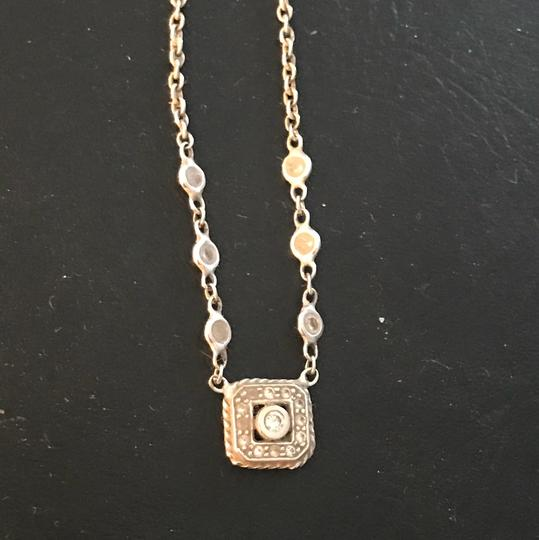 Leslie & Penny For Penny Preville white gold and diamond mini square pendant necklace.