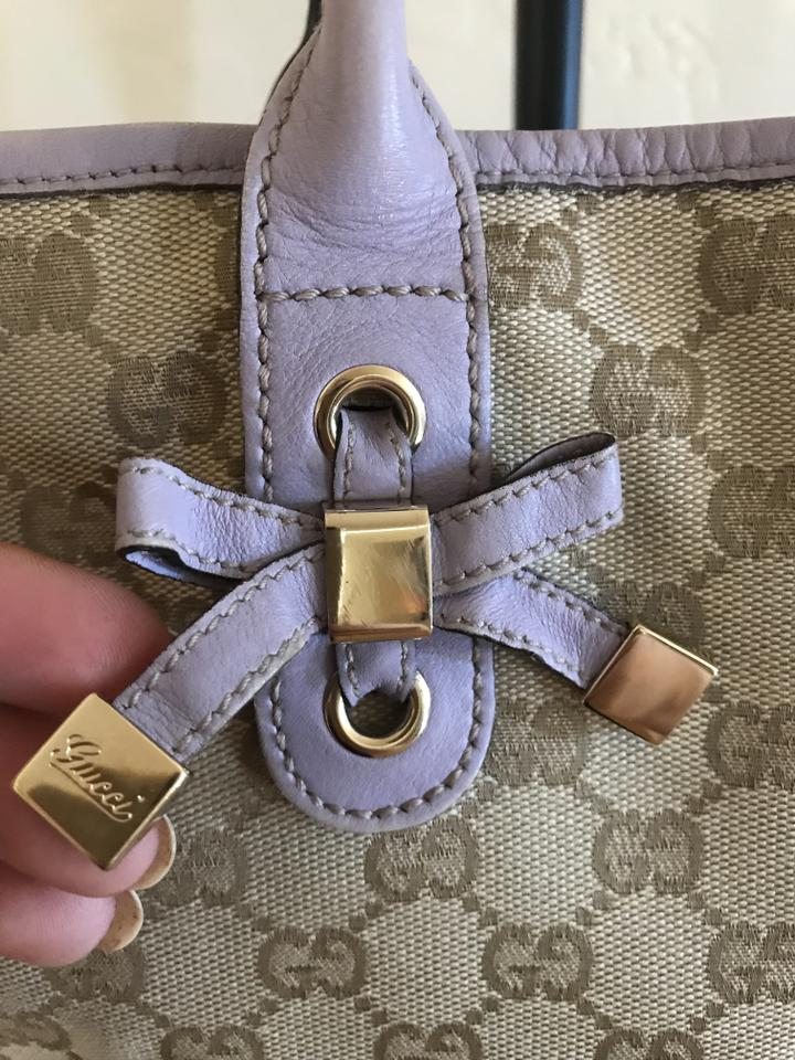7728082512fc Gucci Tote in beige monogram canvas and lavender leather trim Image 11.  123456789101112