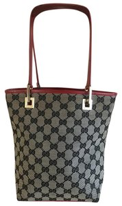fb402135483e Gucci Small Handles Tote in Beige monogram canvas with red leather trim
