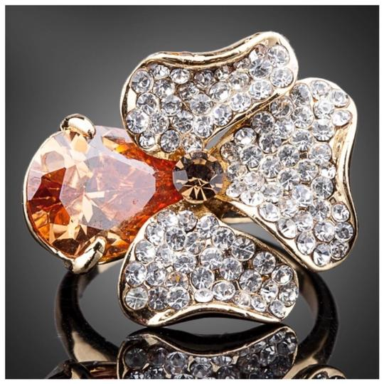Preload https://img-static.tradesy.com/item/22311185/gold-swarovski-crystals-cognac-flower-s8-ring-0-0-540-540.jpg