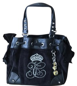 Juicy Couture Satchel in Black with Dark purple lining. The wallet is also black with dark lining.