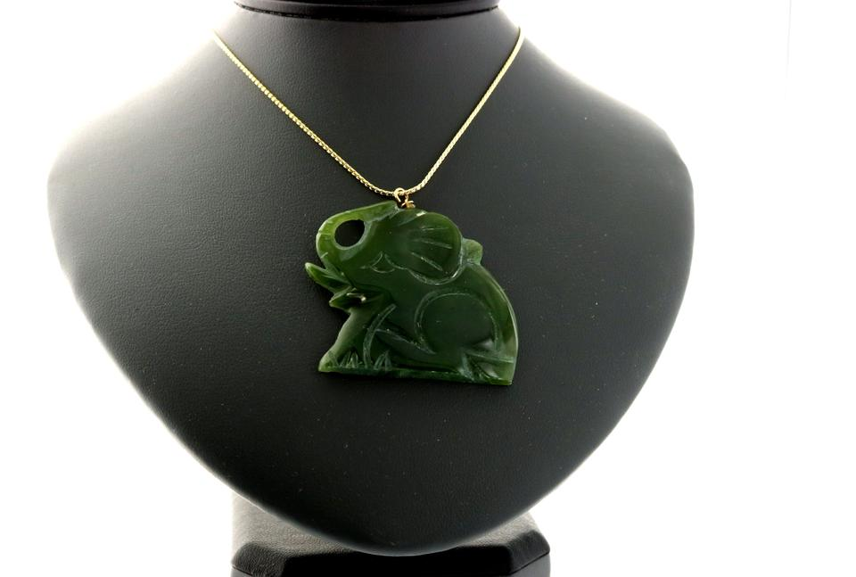 Green real jade elephant pendant on a yellow metal chain necklace aloadofball Gallery