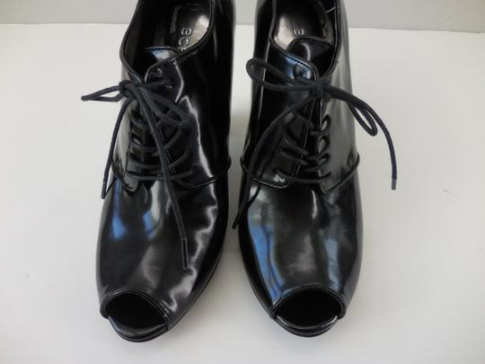 BCBG Lace Up Patent Leather Stacked Heel Black Boots