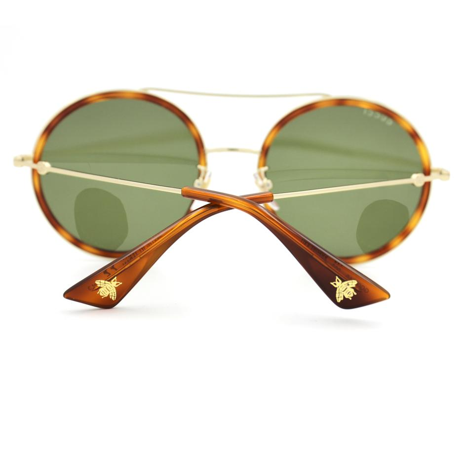 837db8b861a ... Gucci 0061S Round Sunglasses Havana and Gold Frame Image 7. 12345678