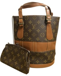 390e23c1616c Added to Shopping Bag. Louis Vuitton Tote in Caramel and brown. Louis  Vuitton Bucket French Company Petit Caramel and Brown Monogram Canvas  Leather Tote