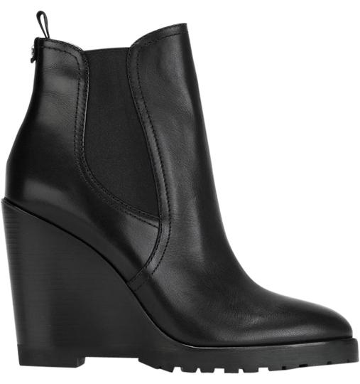 Preload https://img-static.tradesy.com/item/22342098/michael-kors-black-leather-ankle-wedge-bootsbooties-size-us-55-regular-m-b-0-1-540-540.jpg
