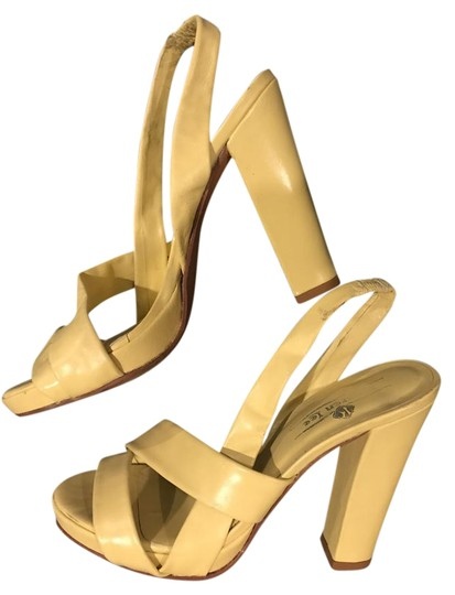 Preload https://img-static.tradesy.com/item/22346033/pale-yellow-strappy-platform-sandals-size-eu-39-approx-us-9-regular-m-b-0-1-540-540.jpg