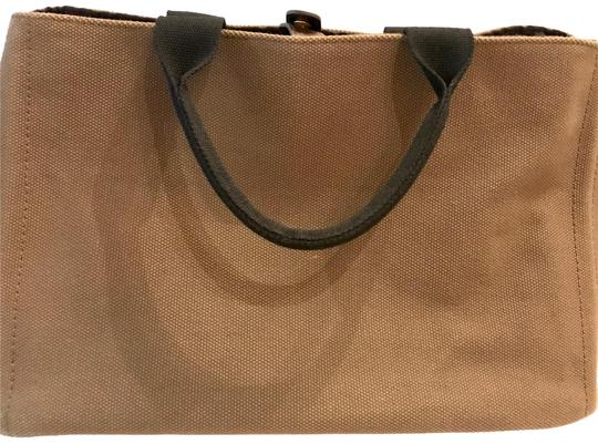 Preload https://img-static.tradesy.com/item/22348464/max-and-co-overnight-travel-tote-brown-canvas-weekendtravel-bag-0-2-540-540.jpg