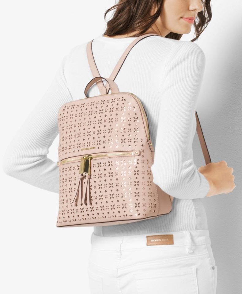 4465460247cd Michael Kors Rhea Medium Slim Floral Perforated Optic White Leather Backpack  - Tradesy