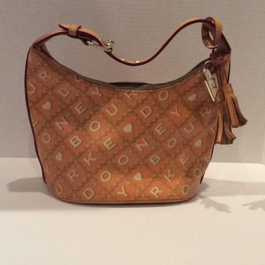 Preload https://img-static.tradesy.com/item/22382093/dooney-and-bourke-color-and-melon-coated-canvas-with-natural-leather-trim-shoulder-bag-0-0-540-540.jpg