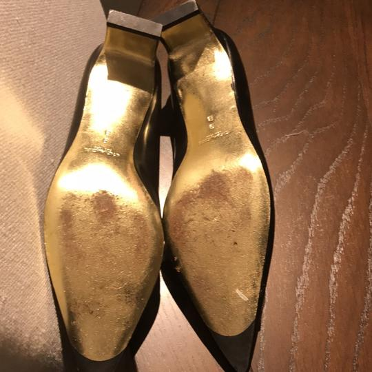 Coach black with a gold bow Pumps Image 1