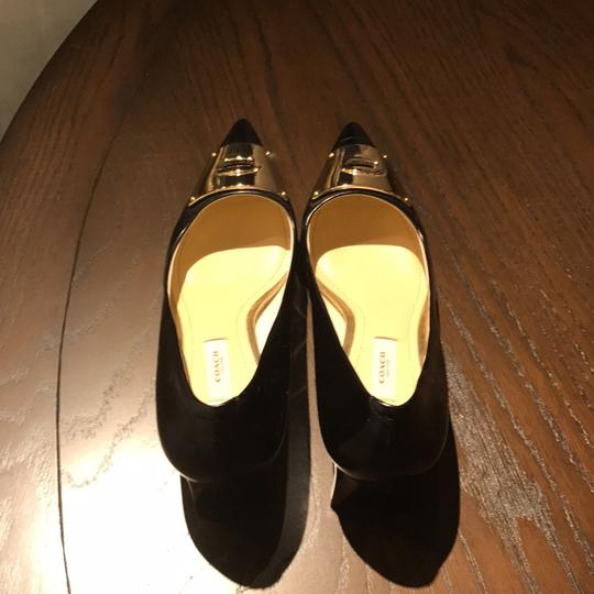 Coach black with a gold bow Pumps Image 3