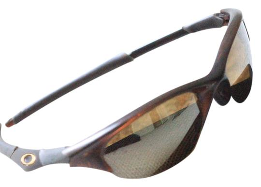 Preload https://item1.tradesy.com/images/translucent-brown-with-mirrored-lens-sunglasses-2239550-0-0.jpg?width=440&height=440