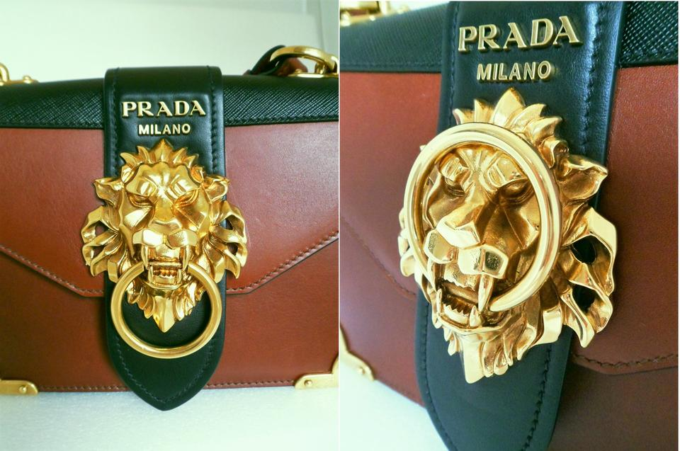 ac087718e63a88 Prada Cahier Notebook Lion Embellished In Stores Now Black & Cognac ...