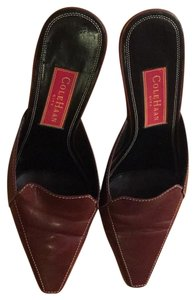Cole Haan brown .. chestnut Mules