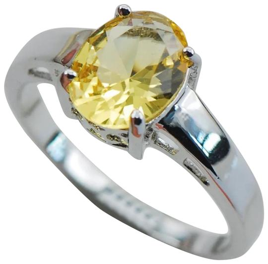Preload https://img-static.tradesy.com/item/22403452/yellow-and-silver-new-citrine-white-gold-filled-ring-0-1-540-540.jpg