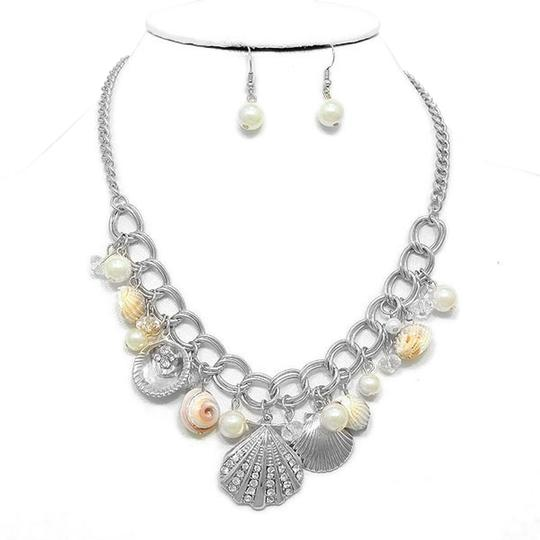 Preload https://item5.tradesy.com/images/silver-rhodium-seaworld-sealife-seashell-pearl-crystal-accent-and-earring-necklace-2240359-0-0.jpg?width=440&height=440