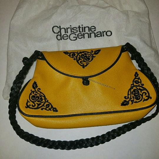 Preload https://img-static.tradesy.com/item/22409865/vintage-never-used-yellow-and-black-leather-shoulder-bag-0-1-540-540.jpg