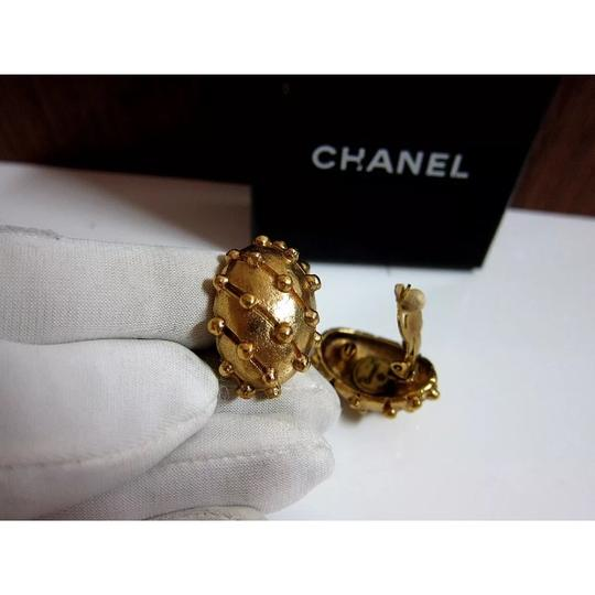 Chanel vintage CHANEL gold tone CACCOON clip on EARRINGS