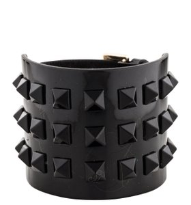 Valentino Gold-tone Valentino black patent leather wide Rockstud bracelet